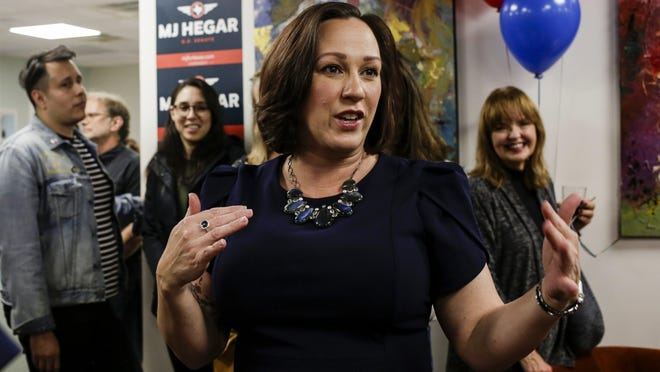 U.S. Senate candidate MJ Hegar visits with supporters during a watch party in Austin on March 3.