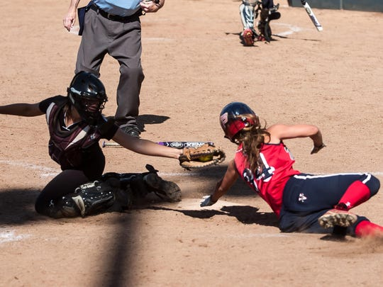 Washington Township's Lauren Sandelier avoids the tag