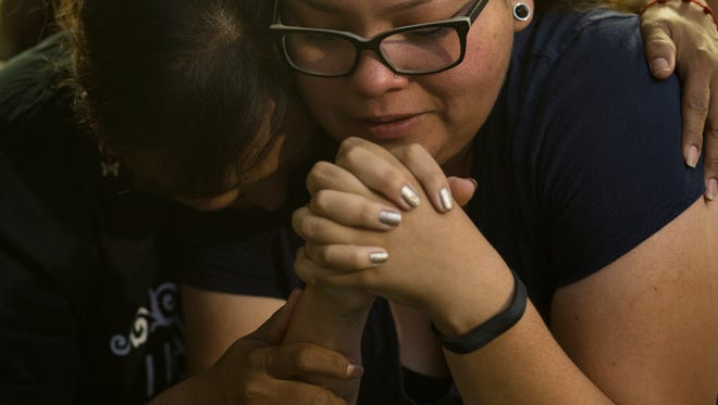 Lizette Zamudio (right, DACA recipient) is comforted by Maria Cruz (DACA recipient mother) after the DACA announcement, September 5, 2017, at the UFCW Hall, 2401 N Central Ave., Phoenix.
