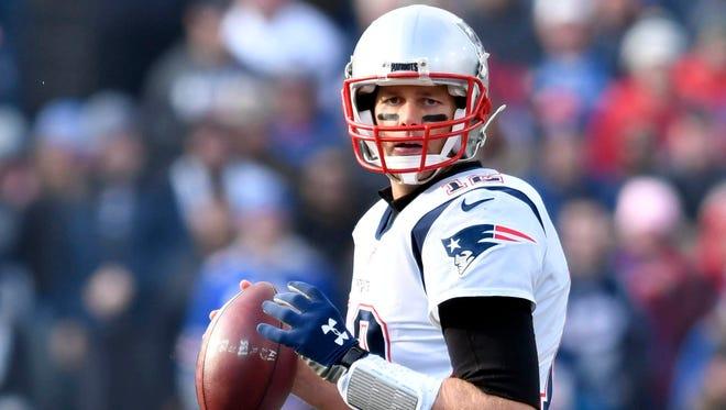 Dec 3, 2017; Orchard Park, NY, USA; New England Patriots quarterback Tom Brady (12) looks to pass during the first quarter against the Buffalo Bills at New Era Field. Mandatory Credit: Mark Konezny-USA TODAY Sports