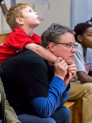 Katie and Connal Baldwin watch an Olympic College basketball game recently at the Bremer Student Center gym. Katie, a sociology teacher, and her husband Ted, a chemistry teacher, have been helping out as tutors, mentors and friends to OC's athletes for years.