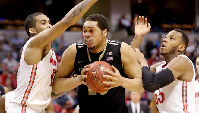Purdue's A.J. Hammons is double-teamed by Ohio State's LaQuinton Ross,left, and Trey McDonald,right, in the second half of game during the Big Ten Men's Basketball Tournament Thursday, March 13, 2014, at Bankers Life Fieldhouse.