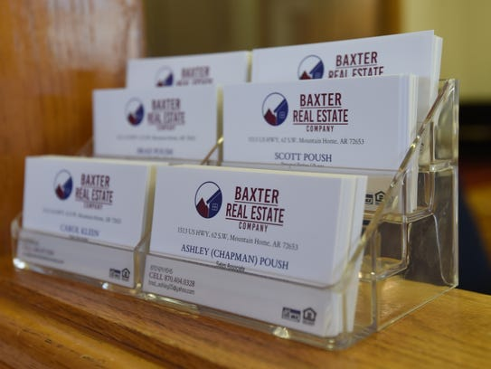 Business cards featuring the Baxter Real Estate Company