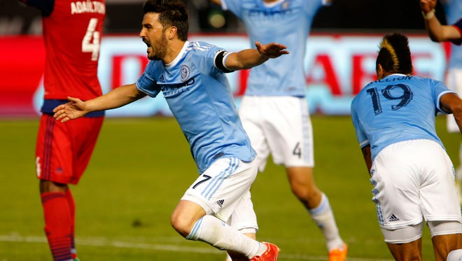 New York City FC forward David Villa (7) reacts after New York City FC forward Khiry Shelton (19) scored a goal against Chicago Fire during second half at Yankee Stadium. The game ended in a 2-2 tie.