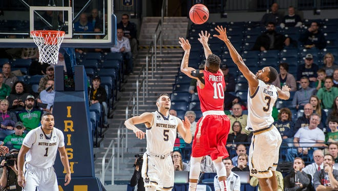 A Bishop Eustace Prep graduate, senior guard Carson Puriefoy launches a shot for Stony Brook in a game against Notre Dame earlier this season.