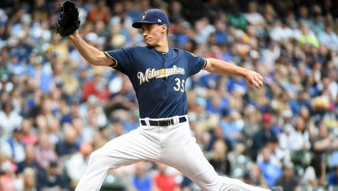 Brewers pitcher Brent Suter entered the game in the first inning after starter Wade Miley was injured. Suter pitched 4 2/3 innings allowing two earned runs.
