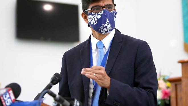 Dr. Michael Lauzardo, division chief of infectious diseases and global medicine at UF Health, speaks about the danger of community transfer of the COVID-19 virus in large gatherings during a press conference ahead of the Fourth of July holiday weekend, at DaySpring Missionary Baptist Church in Gainesville Wednesday.