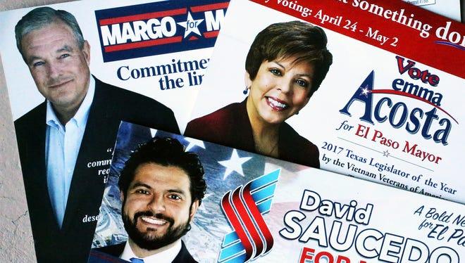 Campaign literature for Dee Margo, Emma Acosta and David Saucedo, three candidates for El Paso mayor.