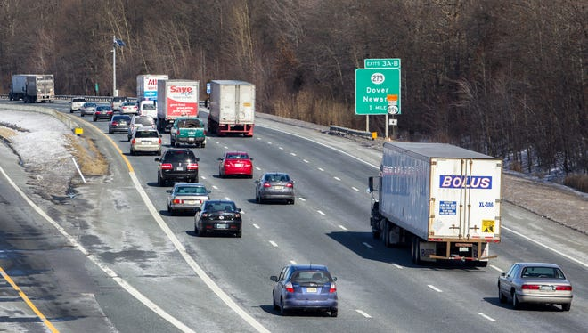 Traffic moves along I-95 near the Newark rest stop on Tuesday afternoon. The speed limit on the interstate between the Maryland line and the I-495 split south of Wilmington is to be raised to 65 mph by this summer.