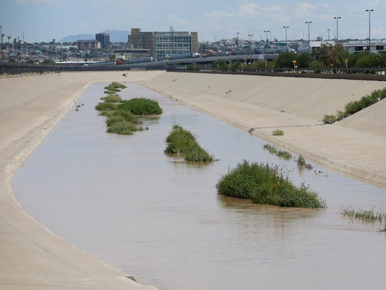 The Rio Grande flows as water has filled its banks