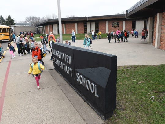 Students leave school to board buses for home this spring at Pleasantview Elementary School in Sauk Rapids. A plan to rebuild the school at its current site is included in a May 23 referendum vote for $86.9 million in school district projects.