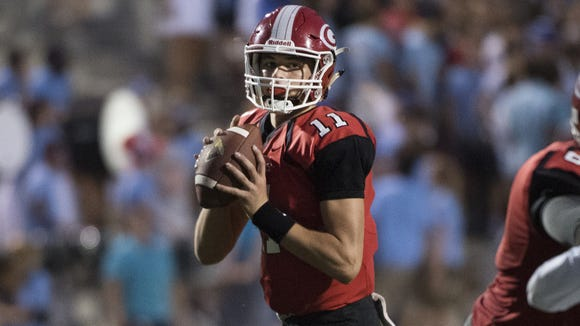 Greenville's Davis Beville (11), who threw for 2,194 yards with 26 touchdowns a year ago, has passed for 1,695 yards with 25 touchdowns this season.