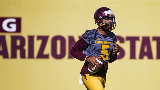ASU QB Manny Wilkins runs with the ball during practice, Monday, March 27, 2017.