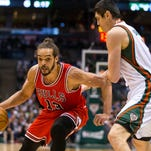 Bulls center Joakim Noah drives to the basket as Milwaukee Bucks forward Ersan Ilyasova defends during the first quarter in Game 6 of the first round of the NBA playoffs Thursday.