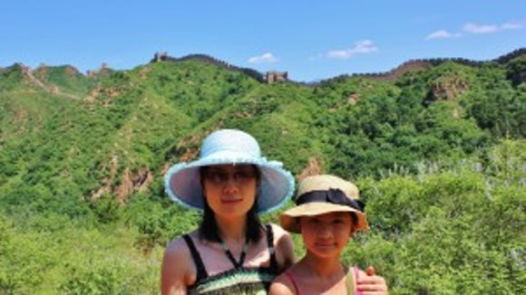Amy Zhong and her mother visiting the Great Wall of China