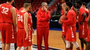 Stony Brook coach Steve Pikiell, center, gathers his players during practice ahead of a first-round men's college basketball game in the NCAA Tournament in Des Moines, Iowa, Wednesday, March 16, 2016. Stony Brook will play Kentucky on Thursday. (AP Photo/Nati Harnik)