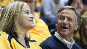 Nashville Mayor Megan Barry sits with Gov. Bill Haslam at a Nashville Predators game at Bridgestone Arena this past season.