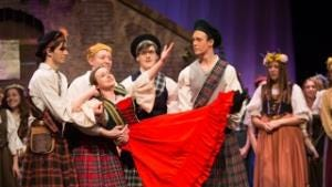 """The Brigadoon villagers (from left to right - Clare Purdy, Gabby Tollefsen and Anna Eberlein) celebrate """"Down on MacConnachy Square."""""""