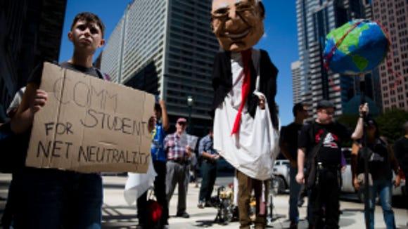 Protesters demonstrate across the street from the Comcast Center Sept. 15, 2014, in Philadelphia.  (AP Photo/Matt Rourke)