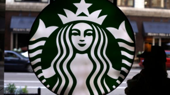 In this Saturday, May 31, 2014 photo, the Starbucks logo is seen at one of the company's coffee shops in downtown Chicago. Starbucks is announcing a new program to help its baristas earn an online degree. (Gene J. Puskar, AP)