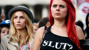 """Women take part in a """"slut walk"""" in London on September 22, 2012 to protest against the police and courts' denial of justice for rape victims."""