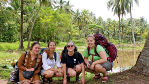 Keeley (far right) with students hiking in Singapore. (Courtesy of Meredith Keeley)