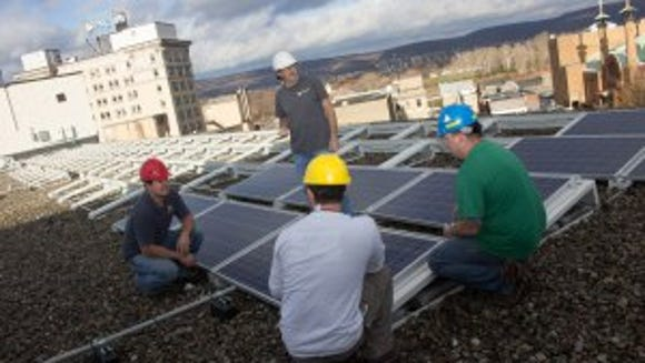 Solar panels being installed at King's on the Square.  (Photo courtesy of John McAndrew)