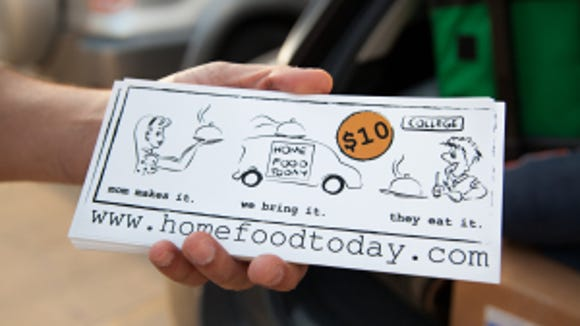 Niraj Patel, founder of Home Food Today, distributes Home Food Today leaflets on the University of Illinois at Urbana-Champaign campus. (Photo: Walbert Castillo)