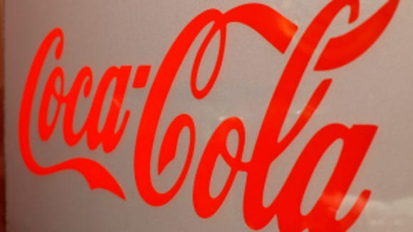 This is a Coca-Cola sign on a drink dispenser at a Wendy's restaurant in Pittsburgh, Monday, March 17, 2014. (AP Photo/Gene J. Puskar)