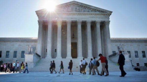 People enter the Supreme Court in Washington, Monday June 29, 2015. (AP Photo/Jacquelyn Martin)