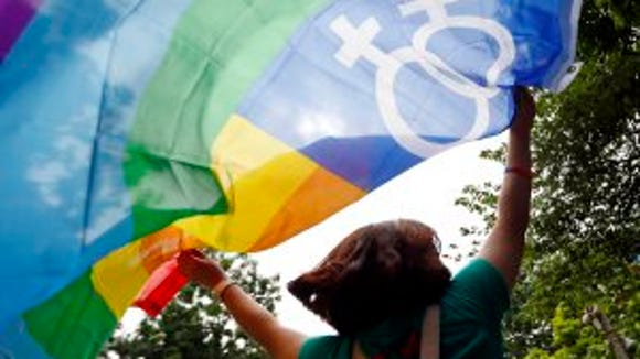 A girl holds a colorful flag on August 3 2014. (Luong Thai Linh, epa)