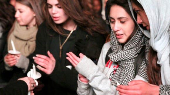 Students at a vigil for Yusor Mohammad Abu-Salha, Razan Mohammad Abu-Salha and Deah Shaddy Barakat on Feb. 10, 2016. (Photo: Hali Tauxe-Stewart)