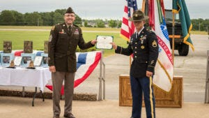 Maneuver Support Center of Excellence and Fort Leonard Wood Command Sgt. Maj. James Breckinridge awards Drill Sergeant Erik Rostamo the certificate naming him Fort Leonard Wood Drill Sergeant of the Year. Rostamo would go on to compete and win at the Army level.