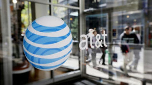 AT&T says three people accessed customers accounts without authorization.