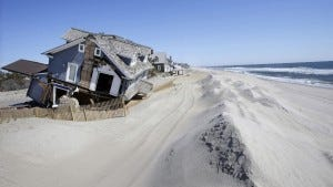 Homes severely damaged in October 2012 by Superstorm Sandy are seen along the beach in Mantoloking.  (AP photo)