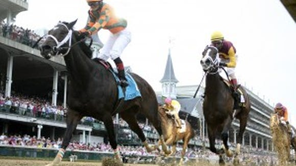 (Photo: Rosie Napravnik celebrates after winning the 2012 Kentucky Oaks on Believe You Can. Courier-Journal photo)
