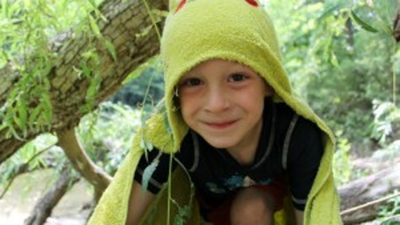"""""""Kids deserve to have fun, down-time, and empty spaces in their lives to fill any way they choose to.... Unscheduled time encourages children to create, imagine, see new possibilities that no one before has thought of."""" Robert Coles (""""Jack as a Frog,"""" photo courtesy of Beth Lathrop)"""