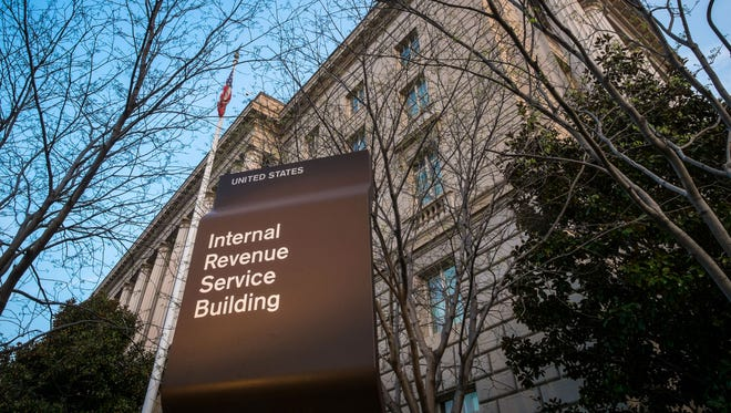 """In this April 13, 2014 file photo, the Internal Revenue Service Headquarters (IRS) building is seen in Washington. Thieves used an online service provided by the IRS to gain access to information from more than 100,000 taxpayers, the agency said Tuesday. The information included tax returns and other tax information on file with the IRS. The IRS said the thieves accessed a system called """"Get Transcript."""" In order to access the information, the thieves cleared a security screen that required knowledge about the taxpayer, including Social Security number, date of birth, tax filing status and street address."""