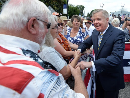 Lindsey Graham greets supporters after he announced