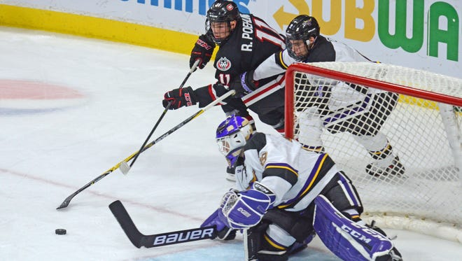 St. Cloud State's Ryan Poehling (11) tries to get to a loose puck in front of MSU-Mankato goalie Jason Pawloski on Oct. 7 at Verizon Wireless Center in Mankato. Poehling has four goals, 11 assists, 10 penalty minutes, two game-winning goals and is a plus-8 in 12 games this season for the Huskies.