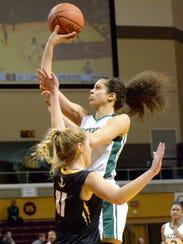 Ypsilanti Arbor Prep junior Mahri Petree shoots against