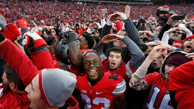 Ohio State players and fans celebrate their win over Michigan in an NCAA college football game Saturday, Nov. 26, 2016, in Columbus, Ohio. Ohio State beat Michigan 30-27 in double overtime. (AP Photo/Jay LaPrete) ORG XMIT: OHJL116