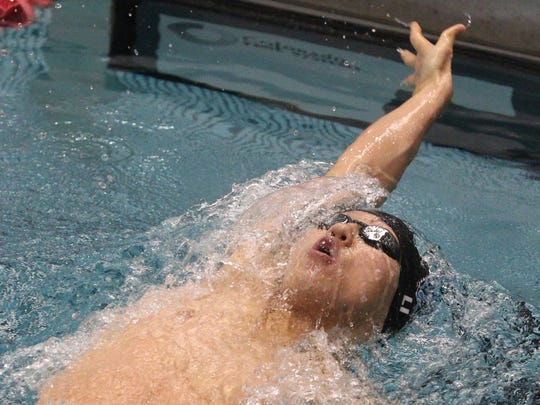 Shoonhsin Li of Horseheads swims in a preliminary of the 200-yard individual medley Friday at the state swimming and diving championships in the Nassau Aquatic Center.