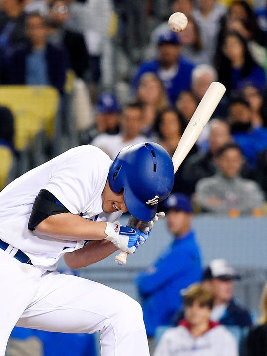 Los Angeles Dodgers' Corey Seager falls after being hit by a pitch during the seventh inning of the team's baseball game against the Pittsburgh Pirates, Tuesday, May 9, 2017, in Los Angeles. (AP Photo/Mark J. Terrill)
