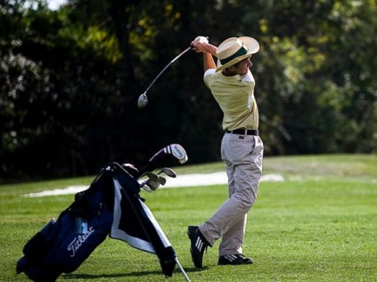 York Catholic's Ryan DePorter watches after moving his ball down the fairway on Thursday at Briarwood Golf Course during the YAIAA Individual Golf Championships. (GAMETIMEPA.COM -- SHANE DUNLAP)