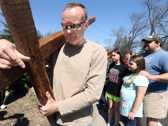 Bill Gripp carries the cross on Good Friday starting at St. GregoryÕs Church, volunteers carrying the cross along South Beverwyck Road to the United Methodist Church.  April 14, 2017, Parsippany, NJ