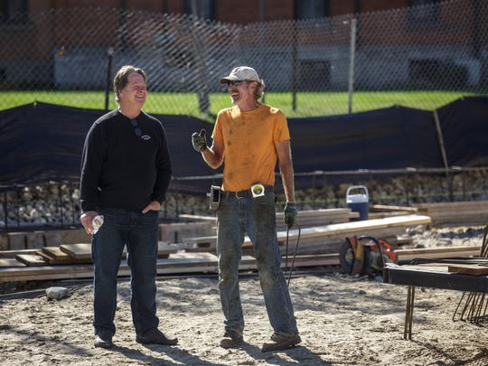 Owner Tom Vertin chats with Dennie Hill, owner of Hill Concrete Foundations, as construction for The Inn on Water Street is underway Wednesday, Oct. 19, 2016 in Marine City.
