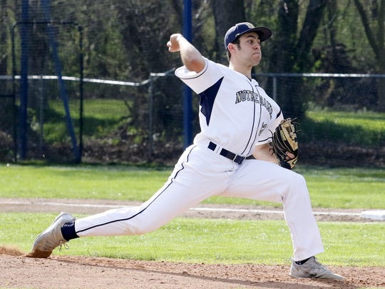 Winning pitcher Nate Snavely delivers a pitch for Elmira Notre Dame on Friday during a 5-4 victory over Tioga in Southport.