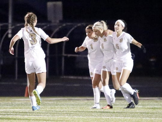 Notre Dame's Peyton Maloney (3), Ellie Mustico (1),