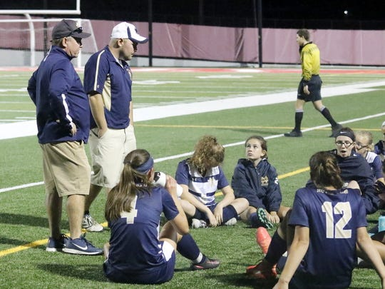 Notre Dame co-head coaches Steve Weber, left, and Kevin Weber talk to their players during a 1-0 loss at Waverly on Sept. 13.
